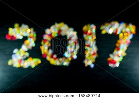 Blurred Happy New Year 2017 With Colourfull Bokeh Black Colour  Background