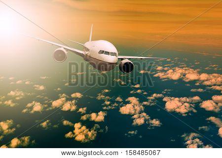 passenger plane flying over beautiful light sky for air traveling theme