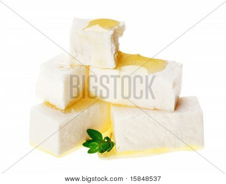 Feta Cheese Cubes With Thyme Twig And Oil Drops