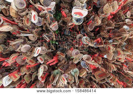Lijiang, China - November 10, 2016: Close Up Of Hand Written Prayers Hanging On A Roof.