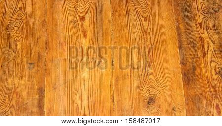 Background of surface of the old wooden planks darkened with time