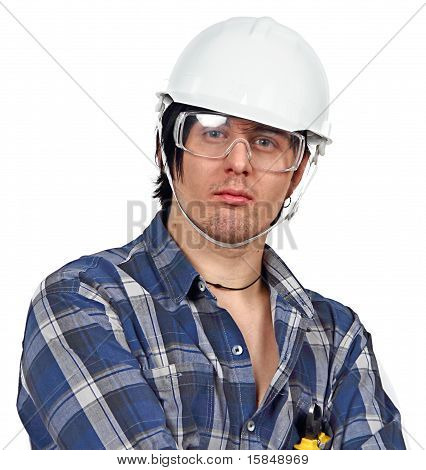 Young Serious Engineer Wearing Helmet And Protective Eyewear