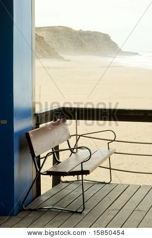 Empty bench at empty beach