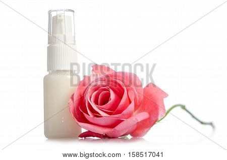 Face cream bottle with pink rose isolated on white