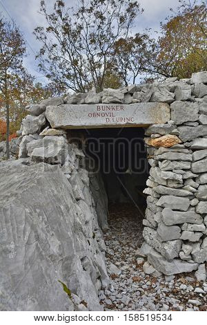 A World War One bunker in the Carso karst limestone area of Friuli Venezia Giulia near Aurisina Italy. The area was a major theatre of battle during the war and many remnants still remain today.