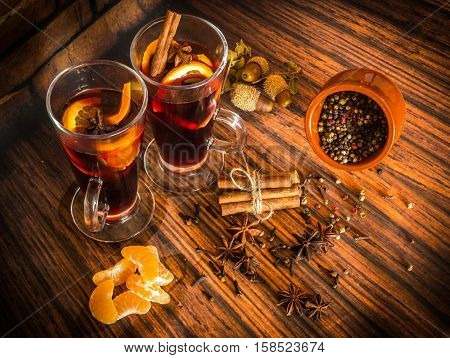 Christmas Hot Mulled Wine With Cinnamon, Cardamom, Anise And Oranges On Wooden Background