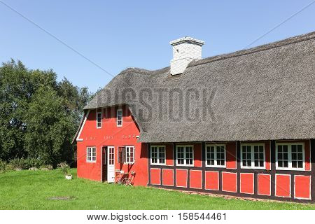 Old and traditional house in Denmark with thatched roof