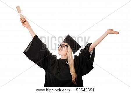 happy college graduate wearing cap and gown holding diploma. isolated on white
