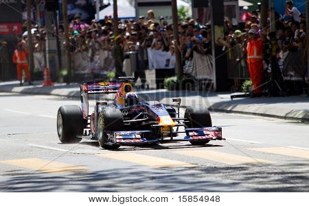 David Coulthard down the straight in a F1 demo