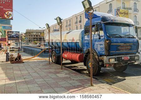 Hurghada, Egypt - November 6, 2006: Sewerage truck on street working - clean up sewerage overflows, cleaning pipelines and potential pollution issues