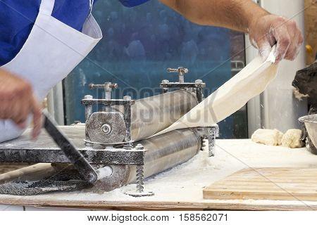 Men Hands Roll Out Dough Close Up.