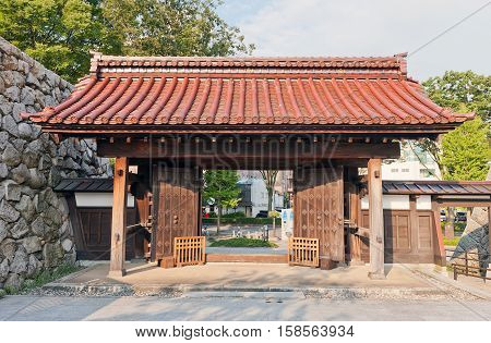 TOYAMA JAPAN - JULY 31 2016: Reconstructed yakuimon type gates of Toyama castle. Castle was founded in 1543 by Jinbo Nagamoto dismantled in 1870 reconstructed in 1954
