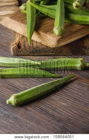 Lady Fingers Or Okra Over Wooden Table Background.