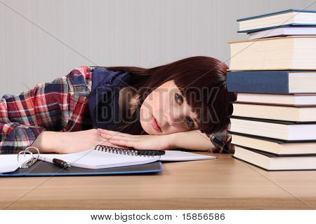 Young Student Tired From Homework Head On Desk