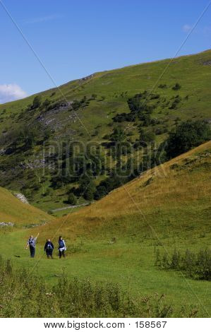 Group Of People Walking In Hills