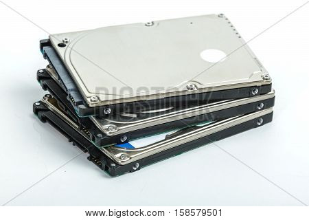 Three 2.5 inch laptop hard disk drives lie on each other. Isolated on white background.