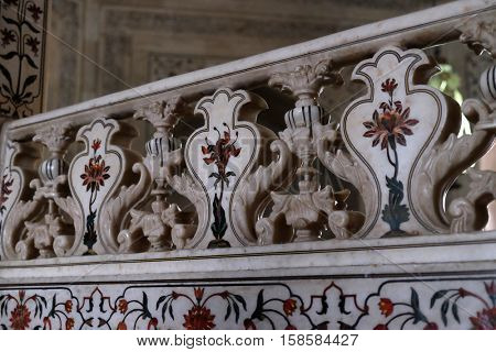AGRA, INDIA - FEBRUARY 14 : Mughal stone art on the facade of the Taj Mahal (Crown of Palaces), an ivory-white marble mausoleum on the south bank of the Yamuna river in Agra on February 14, 2016.