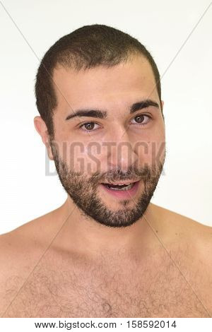 A young unshaven man making a happy expression