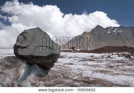 Stone on the glacier moraine in Caucasus mountains