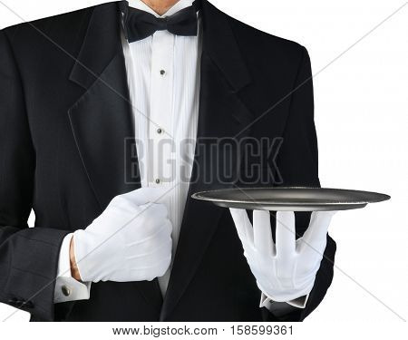 Closeup of a tuxedo wearing waiter holding a silver tray in front of his body. Horizontal format on white.