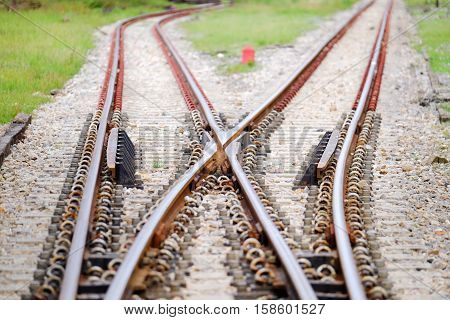 Path of railroad junction at station in Thailand.