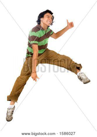Guy Enjoying His Music Jumping