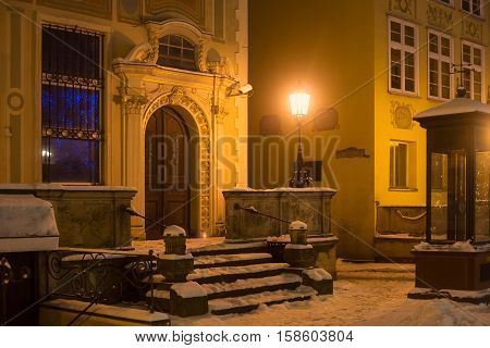 POLAND GDANSK - DECEMBER 30 2014: The main staircase and entrance of the historic building on Long Market (Dlugi Targ) street in night. Gdansk is a Polish city on the Baltic coast and popular center of tourism.