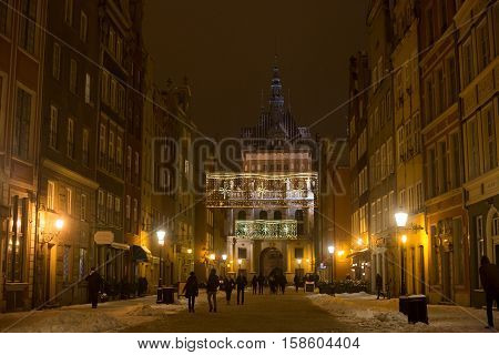 POLAND GDANSK - DECEMBER 30 2014: Nigh town on Long Market (Dlugi Targ) street before Christmas. Gdansk is a Polish city on the Baltic coast and popular center of tourism.