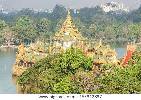 Golden Karaweik palace on Kandawgyi lake looks like an ancient royal barge. Yangon, Myanmar