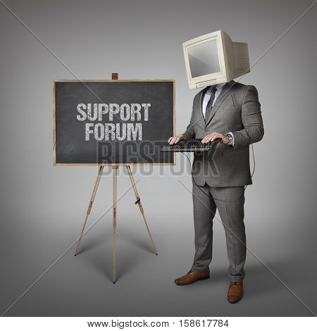 Support forum text on blackboard and computer monitor on businessman head