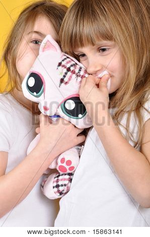 Children With A Toy Plush Cat