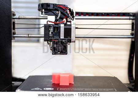3d printer and printed models cubes coral