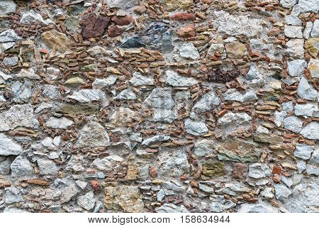 Background texture of wall with several kinds of stones and cement