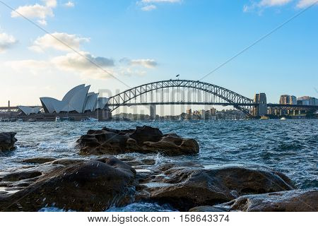 View of  Sydney Opera House And Harbour Bridge at sunset from Mrs macqurie's Chair.NOV 28,2016 The Sydney Opera House is a famous arts center. It was designed by Danish architect Jorn Utzon, finally opening in 1973.