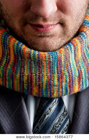 Businessman In Grey Suit And Colorful Scarf