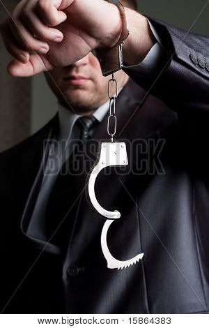 Businessman With Unlocked Handcuffs