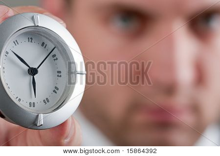 Businessman Showing Clock To You