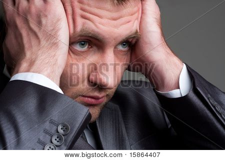 Exhausted Sad Businessman Holding His Head