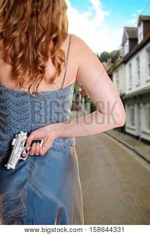 back of woman waiting on street with gun