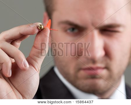 Businessman Aiming By Dart