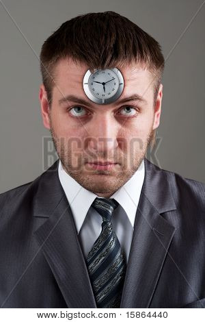 Businessman Looking To Clock In Head