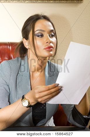 Woman With Sheet Of Paper