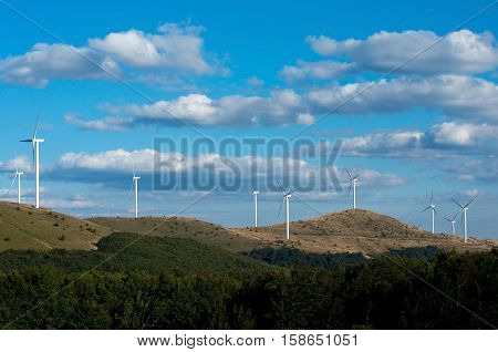 Horizontal wind turbines. Renewable energy. Obtaining electricity from wind. Preservation of nature.