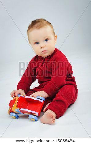 baby boy plaing his toy car