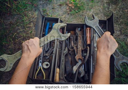 Mechanic hand hold two spanner tools. Wrench tools