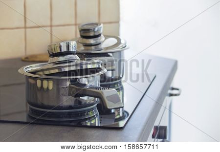 Stainless steel cooking pot on a stove in a kitchen