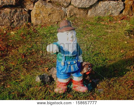 Figurine Dwarf. This figure is in the children's park. Dwarf meets children and invites to a fairy tale. There are many fairy tale characters. The park is rich in attractions, beautiful vegetation. Mom, grandma's with great pleasure coming here. They are