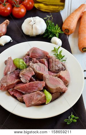 Raw veal in pieces for beef stew bourguignon