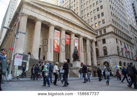 New York, United States of America - November 18, 2016: People in front of the Federal Hall in Lower Manhattan