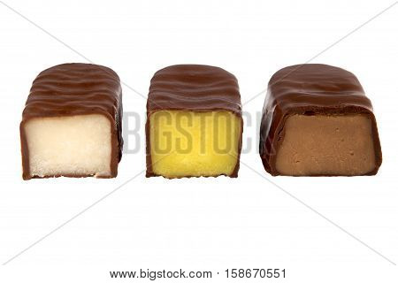 Chocolate candy with filling isolated on a white background. Cut chocolate candies with different fillings.